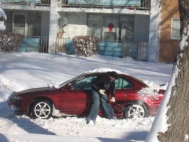 guy's car stuck in snow